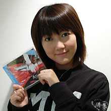 Momoi holding a copy of her new CD